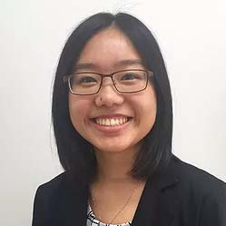 Dr Grace Ho, a female GP, smiling inside the GP Clinic